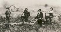 Farming in Tarmola. Men cleaning field.<br /> (Ivan Lukkarinen)